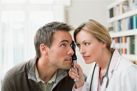 scope - Doctor examining patient's eye in doctor's office Stock Photo - Premium Royalty-Free, Code: 635-03685375