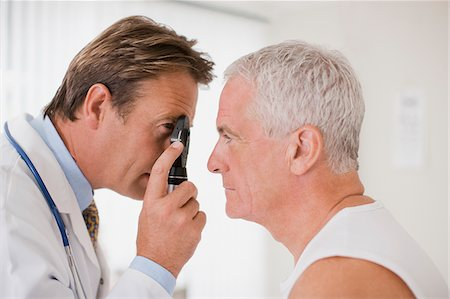 scope - Doctor examining patient's eye in doctor's office Stock Photo - Premium Royalty-Free, Code: 635-03685376