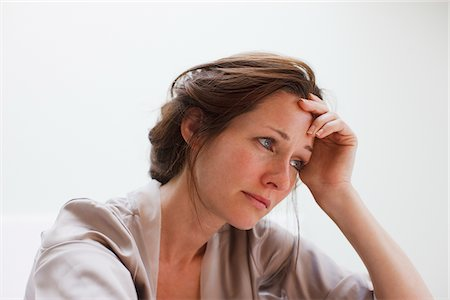 Depressed woman with head in hands Stock Photo - Premium Royalty-Free, Code: 635-03685386