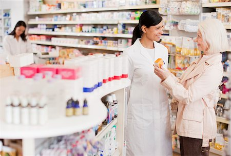 Pharmacist talking to customer in drug store Stock Photo - Premium Royalty-Free, Code: 635-03685382