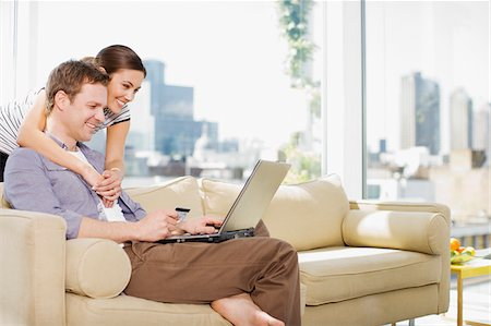 person on phone with credit card - Couple using credit card to purchase merchandise on internet Stock Photo - Premium Royalty-Free, Code: 635-03685469