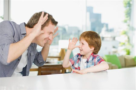 renting - Father and son making faces at one another Stock Photo - Premium Royalty-Free, Code: 635-03685479