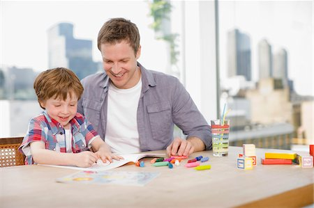 renting - Father watching son coloring Stock Photo - Premium Royalty-Free, Code: 635-03685482