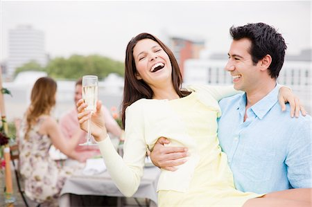 Laughing couple drinking Champagne at outdoor party Stock Photo - Premium Royalty-Free, Code: 635-03685512