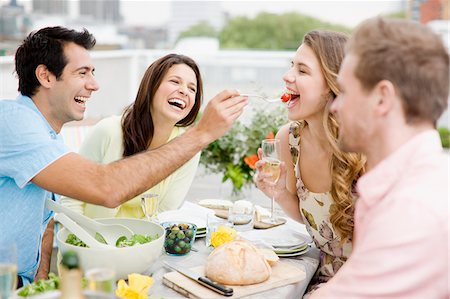 Couples enjoying party on balcony Stock Photo - Premium Royalty-Free, Code: 635-03685513