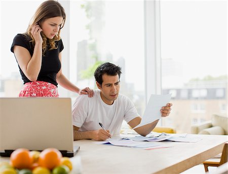 renting - Concerned couple paying bills together Stock Photo - Premium Royalty-Free, Code: 635-03685551