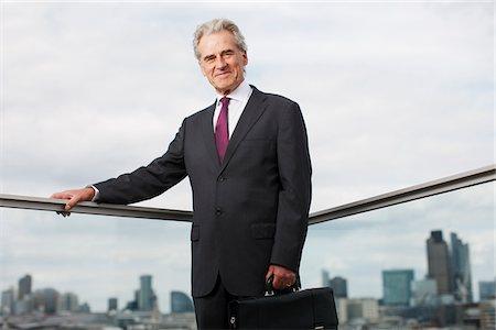superior - Businessman standing on urban balcony Stock Photo - Premium Royalty-Free, Code: 635-03685598
