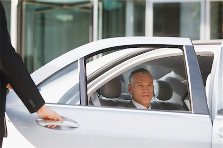 superior - Chauffeur opening car door for businessman Stock Photo - Premium Royalty-Free, Code: 635-03685658