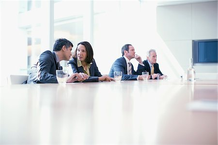 Business people sitting in conference room talking Stock Photo - Premium Royalty-Free, Code: 635-03685651