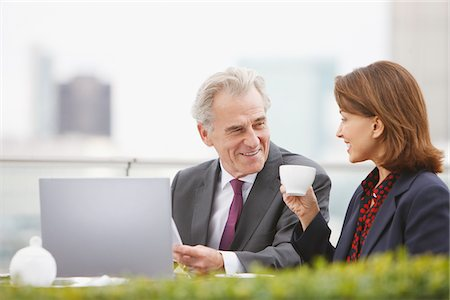 Business people drinking coffee and working outdoors Stock Photo - Premium Royalty-Free, Code: 635-03685652