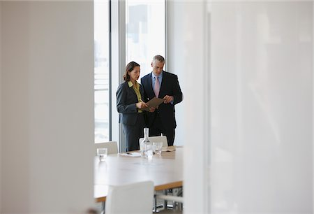 Business people talking in conference room Stock Photo - Premium Royalty-Free, Code: 635-03685698