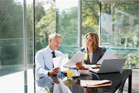 renting - Business people working over breakfast Stock Photo - Premium Royalty-Free, Code: 635-03685704