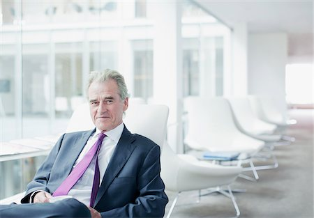 Businessman sitting in office waiting area Stock Photo - Premium Royalty-Free, Code: 635-03685713