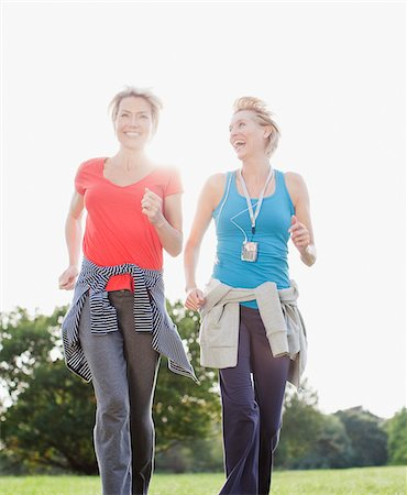 Smiling women jogging together Stock Photo - Premium Royalty-Free, Code: 635-03716053