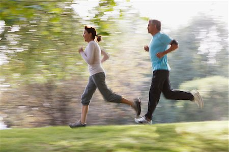 Couple running together Stock Photo - Premium Royalty-Free, Code: 635-03716064
