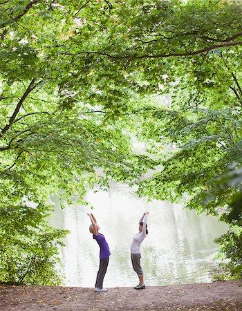 Women stretching before exercise near lake Stock Photo - Premium Royalty-Free, Code: 635-03716066