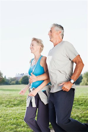 Couple jogging together outdoors Stock Photo - Premium Royalty-Free, Code: 635-03716060