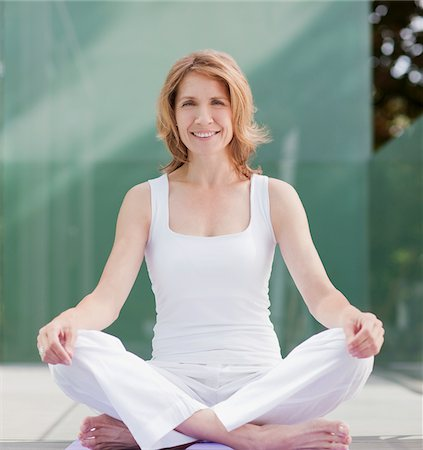 Smiling woman practicing yoga Stock Photo - Premium Royalty-Free, Code: 635-03716062