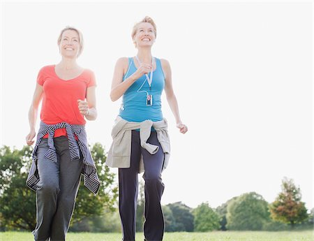 Smiling women jogging together Stock Photo - Premium Royalty-Free, Code: 635-03716086