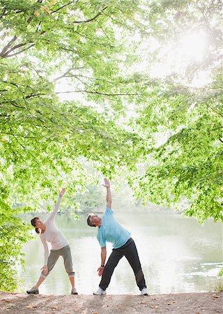 Couple exercising near lake Stock Photo - Premium Royalty-Free, Code: 635-03716083