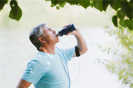 Man drinking water after exercise Stock Photo - Premium Royalty-Free, Code: 635-03716106