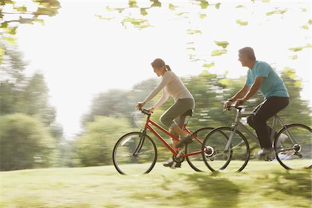 Couple riding bicycles together Stock Photo - Premium Royalty-Free, Code: 635-03716115
