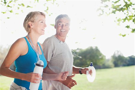 Couple jogging together with water bottles Stock Photo - Premium Royalty-Free, Code: 635-03716111