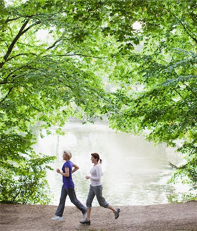Women jogging together near lake Stock Photo - Premium Royalty-Free, Code: 635-03716123