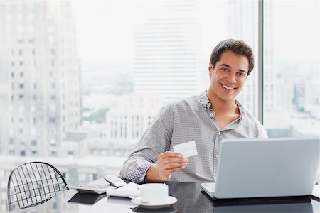 person on phone with credit card - Businessman shopping online with credit card Stock Photo - Premium Royalty-Free, Code: 635-03716217