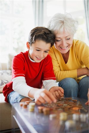 Grandmother and grandson counting coins Stock Photo - Premium Royalty-Free, Code: 635-03716246