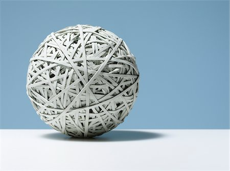 Close up of white rubber band ball Stock Photo - Premium Royalty-Free, Code: 635-03716309