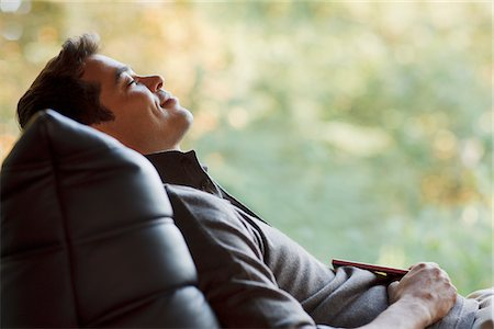 entertainment - Tranquil man napping in chair Stock Photo - Premium Royalty-Free, Code: 635-03716581