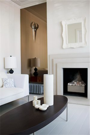 Elegant, white living room with fireplace Stock Photo - Premium Royalty-Free, Code: 635-03752240