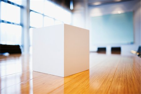 Close up of cube on conference room table Stock Photo - Premium Royalty-Free, Code: 635-03752306