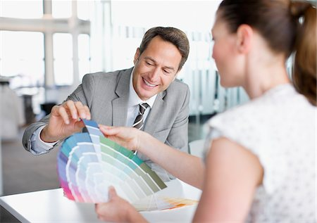 dubious - Business people looking at color swatches together Stock Photo - Premium Royalty-Free, Code: 635-03752337