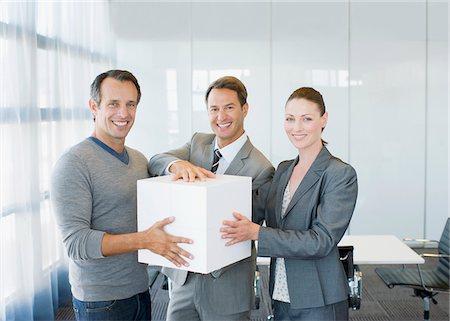 partnership - Business people holding large white cube Stock Photo - Premium Royalty-Free, Code: 635-03752362