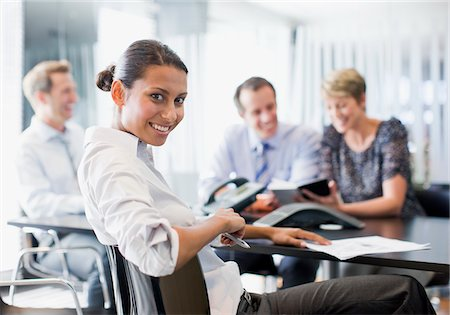 Business people working together in conference room Stock Photo - Premium Royalty-Free, Code: 635-03752379