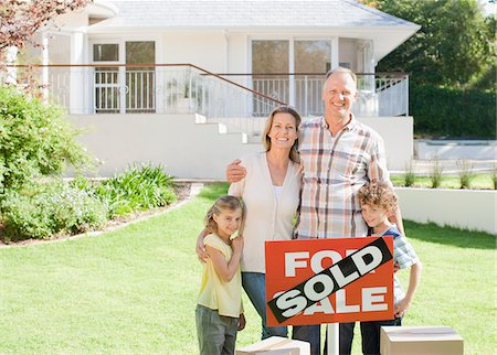 sold sign - Family standing with sold sign of their new house Stock Photo - Premium Royalty-Free, Code: 635-03752510