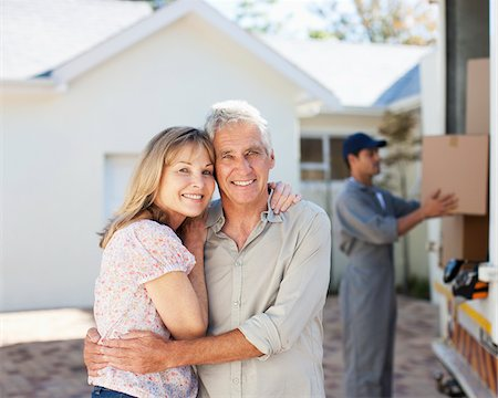 Couple hugging near moving van Stock Photo - Premium Royalty-Free, Code: 635-03752532