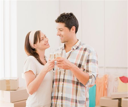 Couple toasting with champagne new house Stock Photo - Premium Royalty-Free, Code: 635-03752552