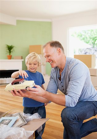 Father showing son model car in new house Stock Photo - Premium Royalty-Free, Code: 635-03752574