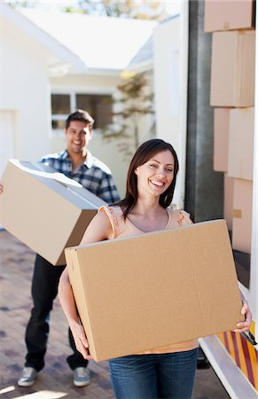 Couple carrying boxes from moving van Stock Photo - Premium Royalty-Free, Code: 635-03752586