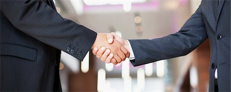 Businessmen shaking hands in office Stock Photo - Premium Royalty-Free, Code: 635-03752617