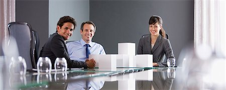 piles of work - Business people stacking white cubes in conference room Stock Photo - Premium Royalty-Free, Code: 635-03752630