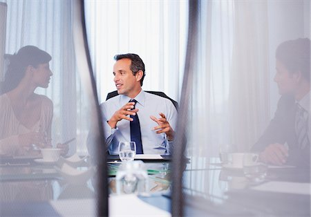 Business people working together in conference room Stock Photo - Premium Royalty-Free, Code: 635-03752644