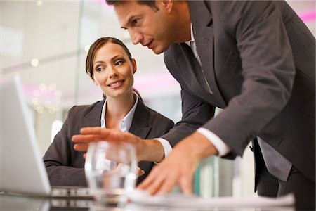 Business people working together on laptop Stock Photo - Premium Royalty-Free, Code: 635-03752653
