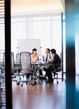 Business people working together in conference room Stock Photo - Premium Royalty-Free, Code: 635-03752685