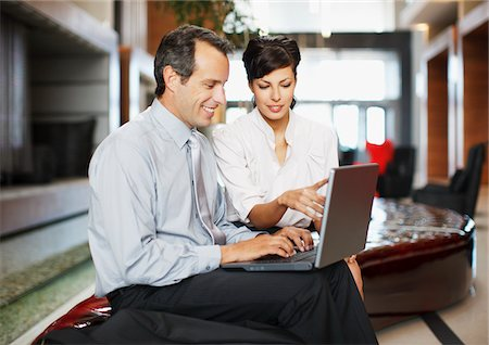 Business people working together in hotel lobby Stock Photo - Premium Royalty-Free, Code: 635-03752702