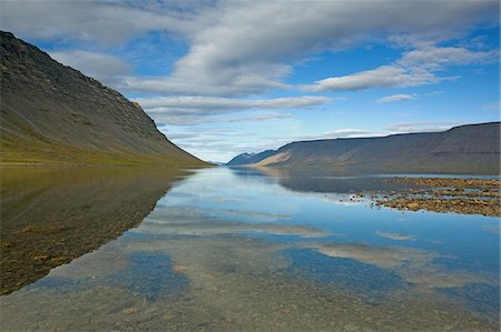 Hill and lake, Dynjandisvogur, Iceland Stock Photo - Premium Royalty-Free, Code: 635-03752759