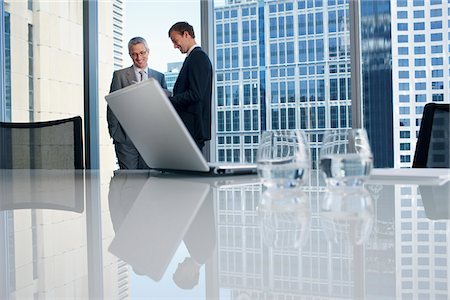 Businessmen working together in conference room Stock Photo - Premium Royalty-Free, Code: 635-03752808